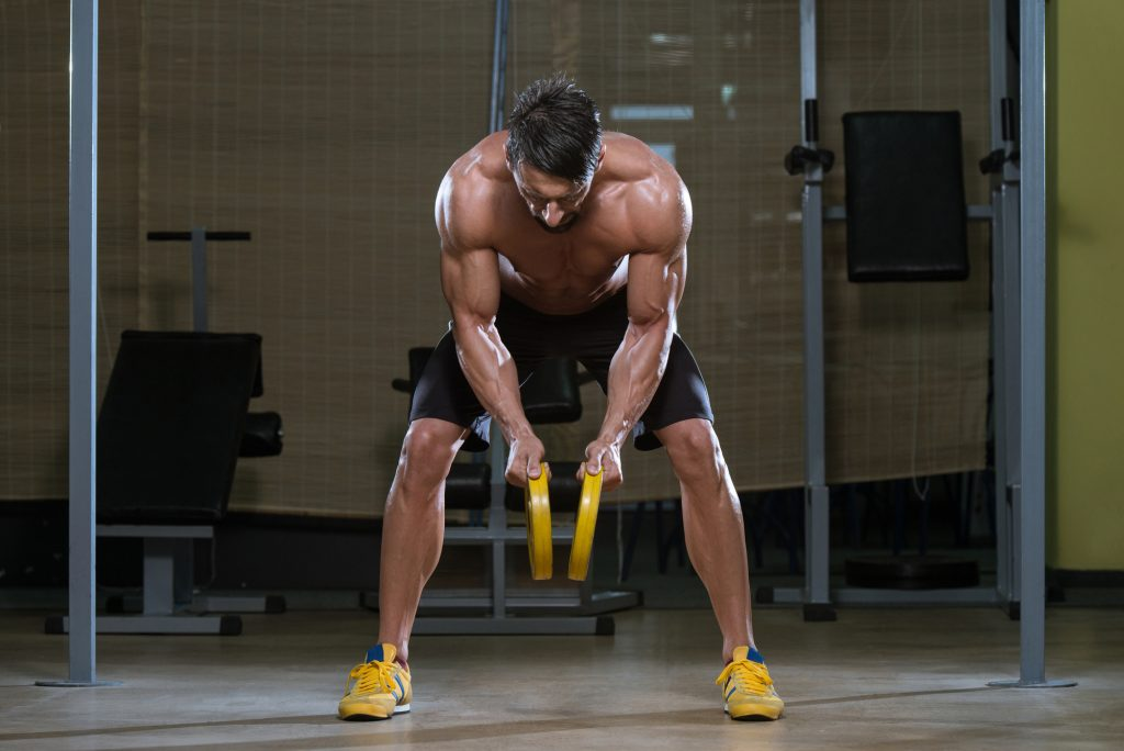 Male Athlete Doing Heavy Weight Exercise For Back and sports performance